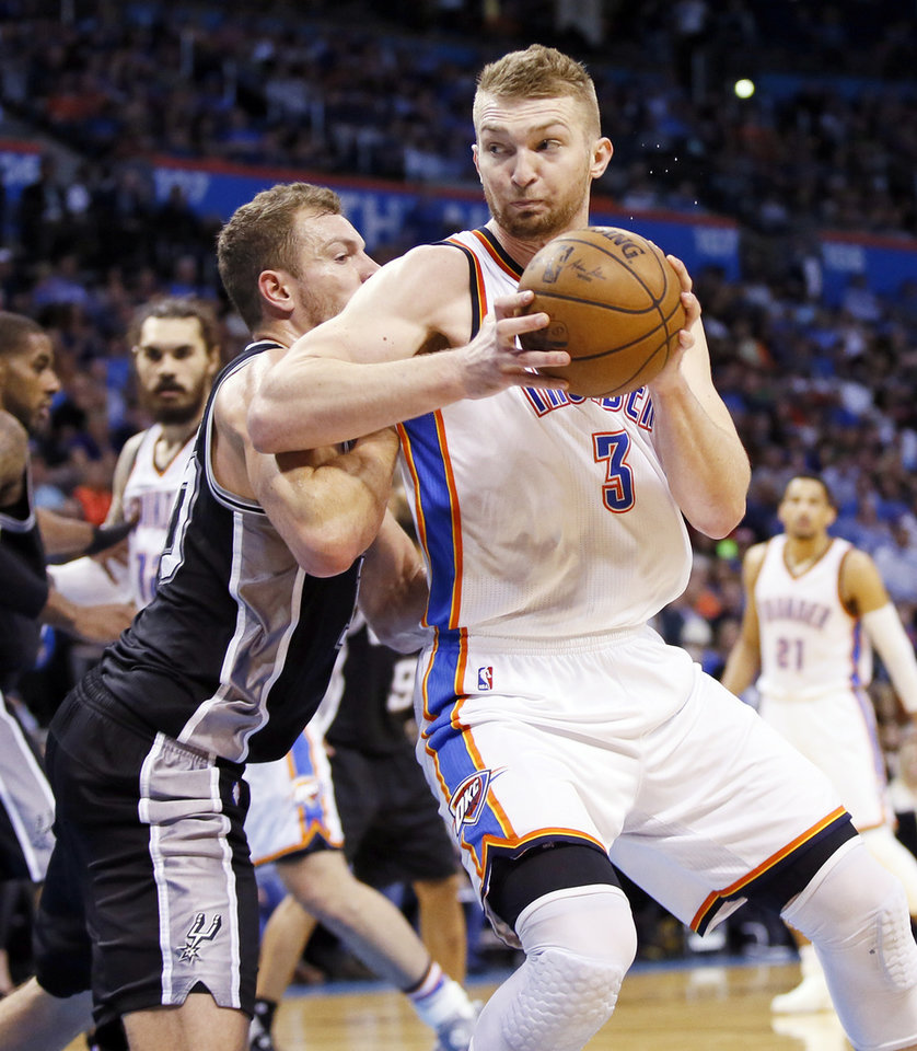 Photo - Oklahoma City's Domantas Sabonis (3) works against San Antonio's David Lee (10) during an NBA basketball game between the Oklahoma City Thunder and San Antonio Spurs at Chesapeake Energy Arena in Oklahoma City, Friday, March 31, 2017. San Antonio won 100-95. Photo by Nate Billings, The Oklahoman