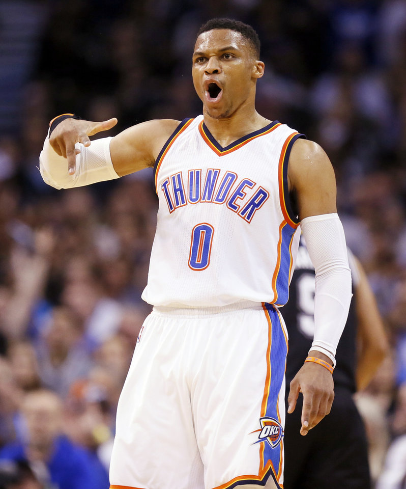 Photo - Oklahoma City's Russell Westbrook (0) reacts after making a shot during an NBA basketball game between the Oklahoma City Thunder and San Antonio Spurs at Chesapeake Energy Arena in Oklahoma City, Friday, March 31, 2017. Photo by Nate Billings, The Oklahoman