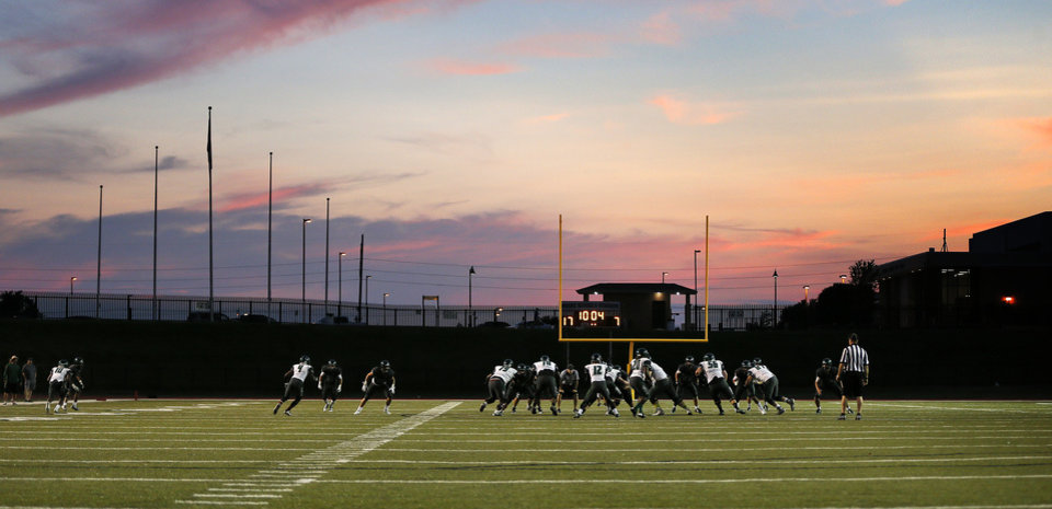 Photo -  Edmond Santa Fe and Norman North play during a high school football scrimmage Aug. 20 at Moore Schools Stadium in Moore. [Photo by Nate Billings, The Oklahoman]