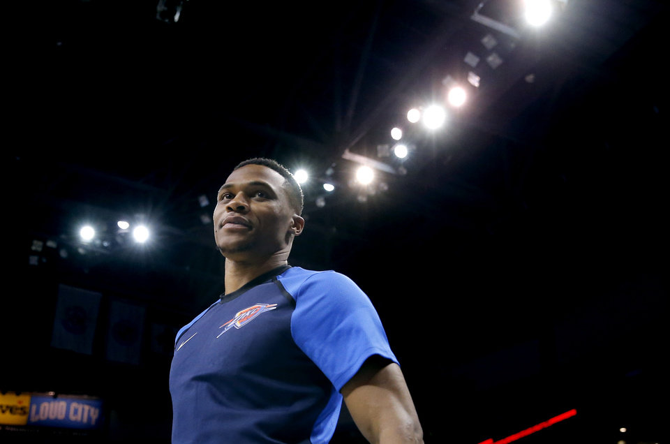 Photo - Oklahoma City's Russell Westbrook (0) stands on the base line during a NBA preseason game between the Oklahoma City Thunder and Milwaukee Bucks at Chesapeake Energy Arena in Oklahoma City,  Tuesday, Oct. 9, 2018. Iowa State won 48-42. Photo by Sarah Phipps, The Oklahoman