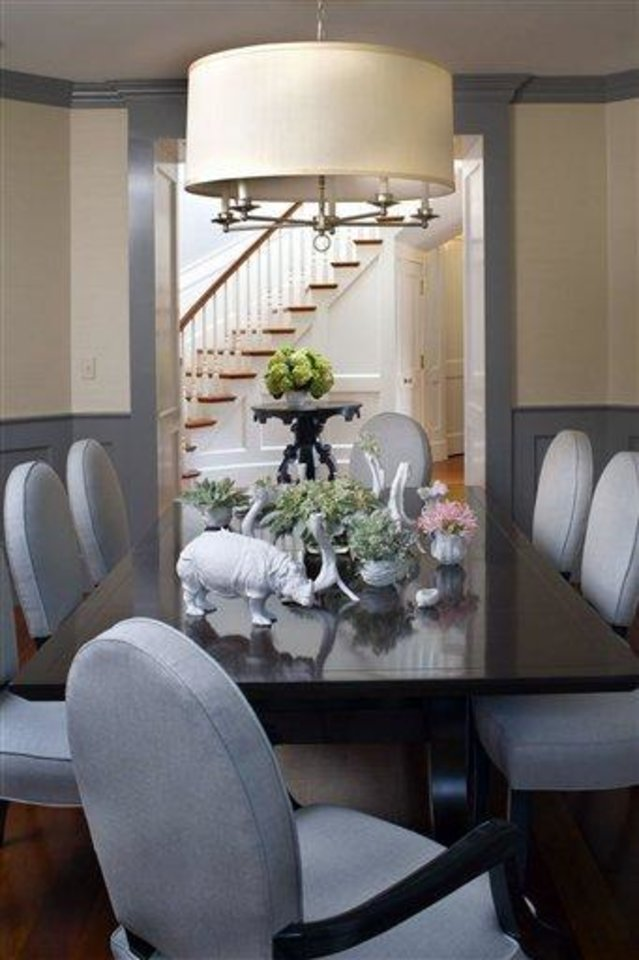 Photo - This undated photo courtesy of Betsy Burnham shows a dining room designed by Betsy Burnham. As comfort has become a priority, pretty but unforgiving chairs are definitely out. Burnham advises testing out new dining chairs before you buy them, since you want your table to be a place where people will enjoy lingering for hours.   (AP Photo/Betsy Burnham)