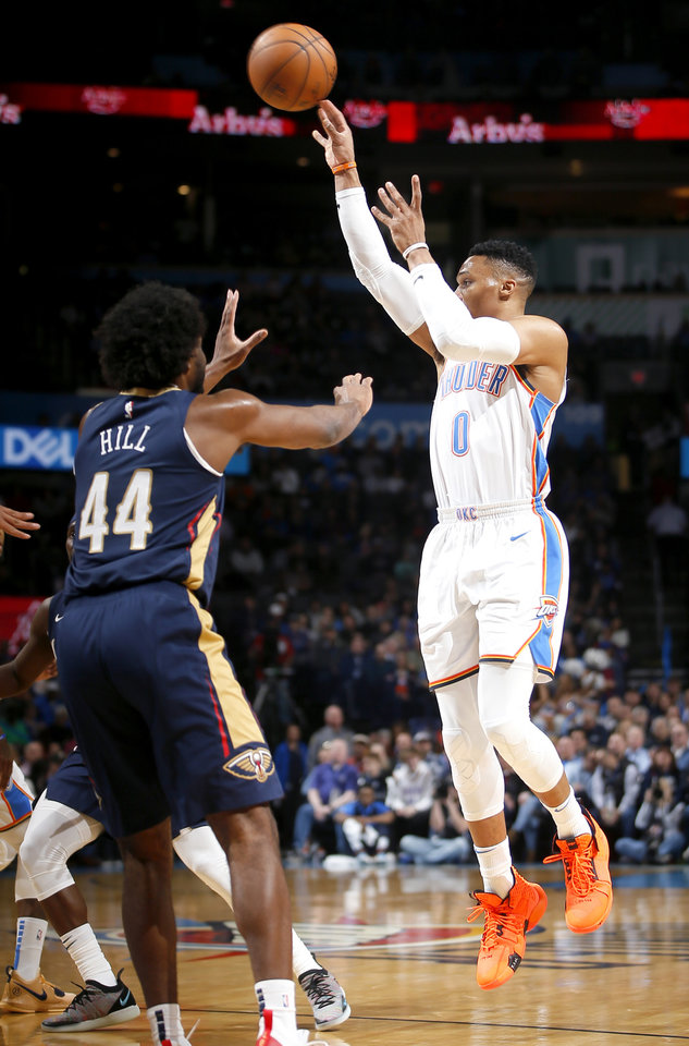 Photo - Oklahoma City's Russell Westbrook (0) passes the ball as New Orleans' Solomon Hill (44) defends during an NBA basketball game between the Oklahoma City Thunder and the New Orleans Pelicans at Chesapeake Energy Arena in Oklahoma City, Thursday, Jan. 24, 2019. Photo by Bryan Terry, The Oklahoman