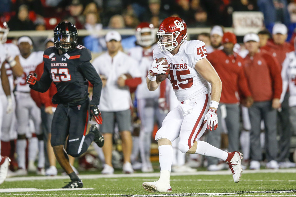 Photo - Oklahoma Sooners fullback Carson Meier (45) runs the ball during the NCAA football game between the Texas Tech Red Raiders and the Oklahoma Sooners at Jones AT&T Stadium in Lubbock, Texas on Saturday, November 03, 2018. IAN MAULE/Tulsa World