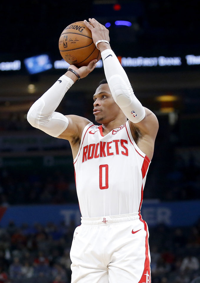 Photo - Houston's Russell Westbrook (0) shoots the ball during the NBA basketball game between the Oklahoma City Thunder and the Houston Rockets at the Chesapeake Energy Arena in Oklahoma City,  Thursday, Jan. 9, 2020.  [Sarah Phipps/The Oklahoman]