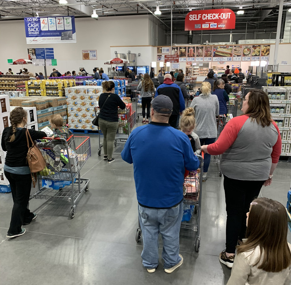 Photo - Shoppers wait in line at COSTCO in Oklahoma City Monday, March 16, 2020. Photo by Bailey Huntsman/The Oklahoman