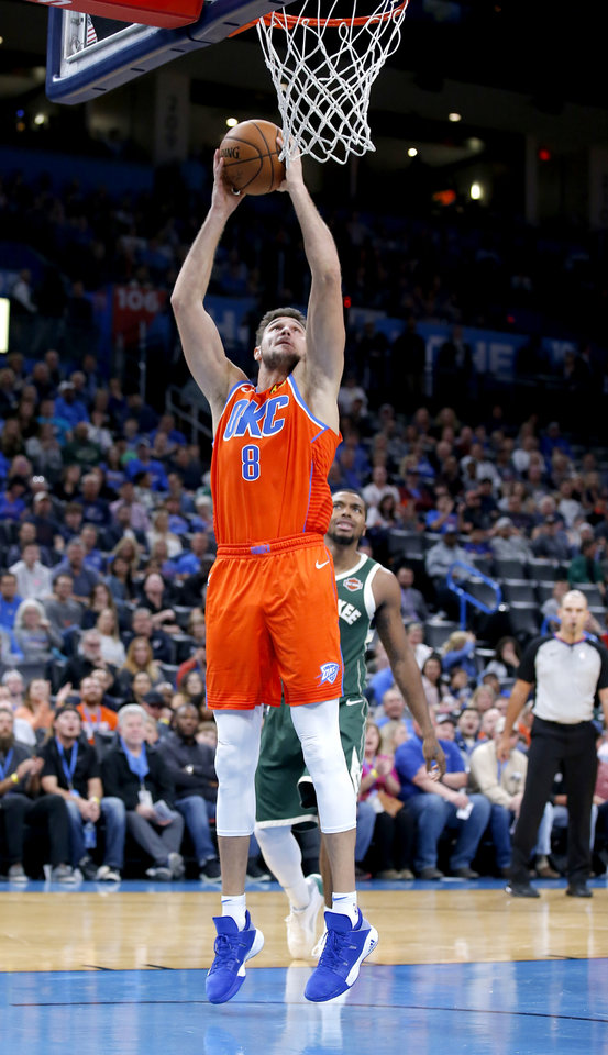 Photo - Oklahoma City's Danilo Gallinari (8) goes up for a dunk during the NBA game between the Oklahoma City Thunder and the Milwaukee Bucks at Chesapeake Energy Arena,   Sunday, Nov. 10, 2019.  [Sarah Phipps/The Oklahoman]