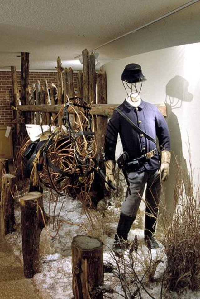 Photo - A cavalry uniform from the era of the Battle of the Washita is shown with other cavalry gear at the Black Kettle Museum in Cheyenne. (OKLAHOMAN ARCHIVES)