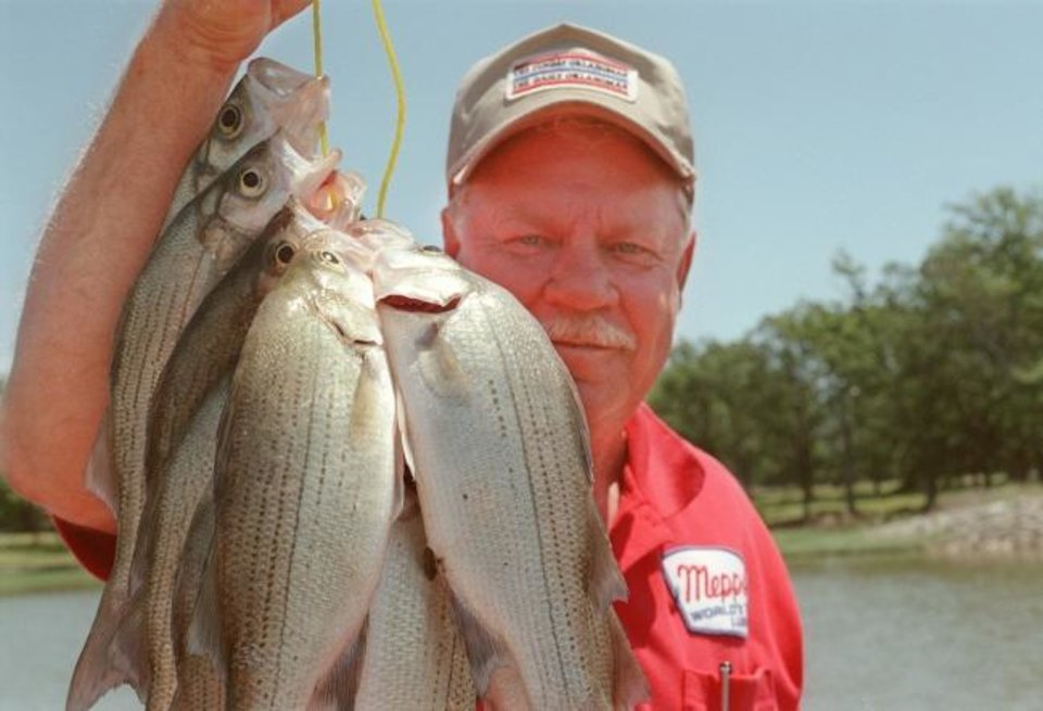 Photo -  Covey Bean holds a stringer of fish caught in 1999. [OKLAHOMAN ARCHIVES]