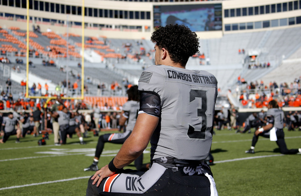 Photo - Oklahoma State's Spencer Sanders (3) warms up before the college football game between the Oklahoma State University Cowboys and the Kansas Jayhawks at Boone Pickens Stadium in Stillwater, Okla., Saturday, Nov. 16, 2019.  [Sarah Phipps/The Oklahoman]