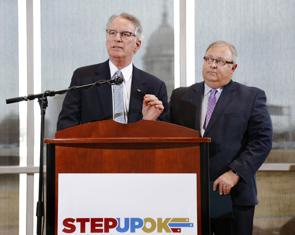 Photo - David Rainbolt, an Oklahoma banker, left, and attorney Glenn Coffee, former state senator and Oklahoma Secretary of State,  unveil reform and revenue measures at a news conference in the atrium of the Oklahoma History Center.  Frustrated by a legislative budget impasse that has stalled state progress, a statewide coalition of Oklahoma business and civic leaders (STEPUPOK) proposed a comprehensive solution Thursday, Jan. 11, 2018,  that would increase state revenues, fund $5,000 teacher pay raises and alter the structure of state and county government.  The proposal calls for raising gross production, motor fuel and cigarette taxes, while eliminating certain individual income tax deductions and loopholes.  The business leaders said their willingness to support the proposed revenue hikes is directly tied to lawmakers' willingness to vote for $5,000 teacher pay increases and embrace 10 reforms to the structure of state and county government, many of which also would require the public's approval through votes on constitutional amendments.  Photo by Jim Beckel, The Oklahoman