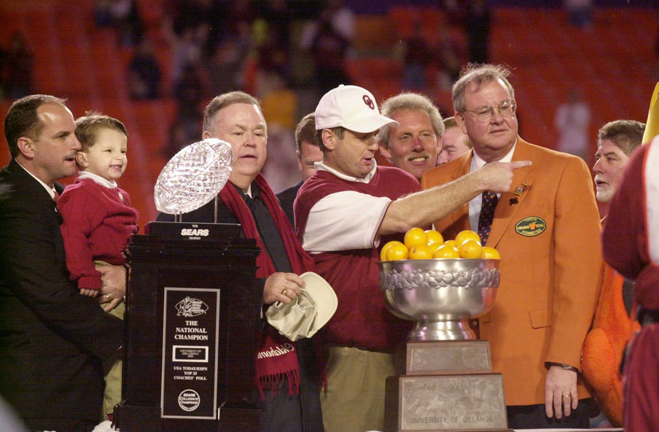Photo - NATIONAL CHAMPIONSHIP, COLLEGE FOOTBALL: OU vs Florida State at the Orange Bowl. Coach Bob Stoops and Pres. David Boren and Joe Castiglione (sp) accept trophies. Staff photo  by Bryan Terry.