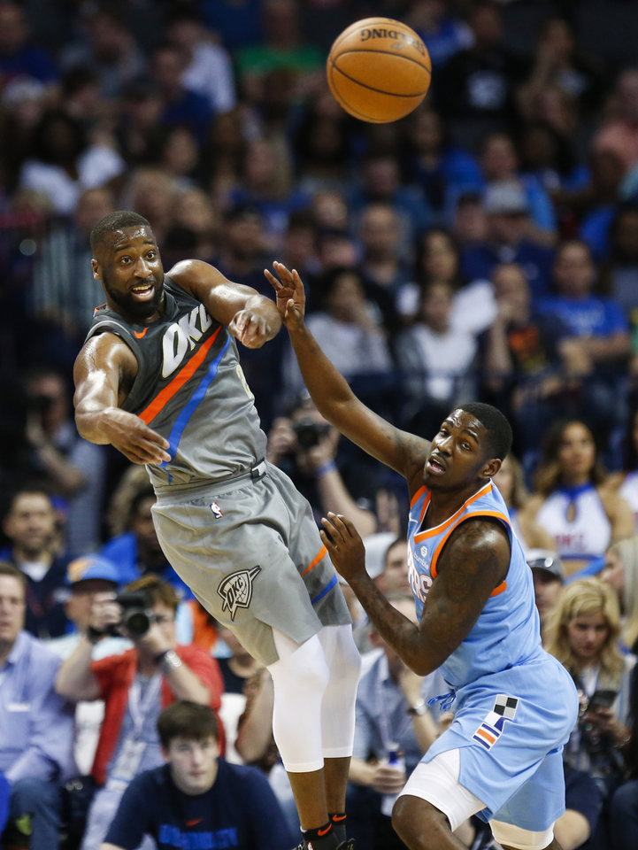 Photo - Oklahoma City's Raymond Felton (2) passes away from LA's Jawun Evans (1) during an NBA basketball game between the Oklahoma City Thunder and the Los Angeles Clippers at Chesapeake Energy Arena in Oklahoma City, Friday, March 16, 2018. Oklahoma City won 121-113. Photo by Nate Billings, The Oklahoman