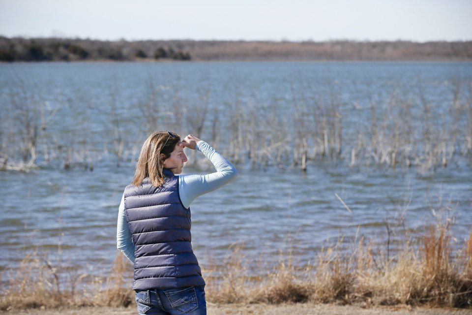 Photo - Jennell James stands on the shore of Clear Creek Lake near Duncan, Okla., Saturday, Feb. 1, 2020. Her father, Darrell