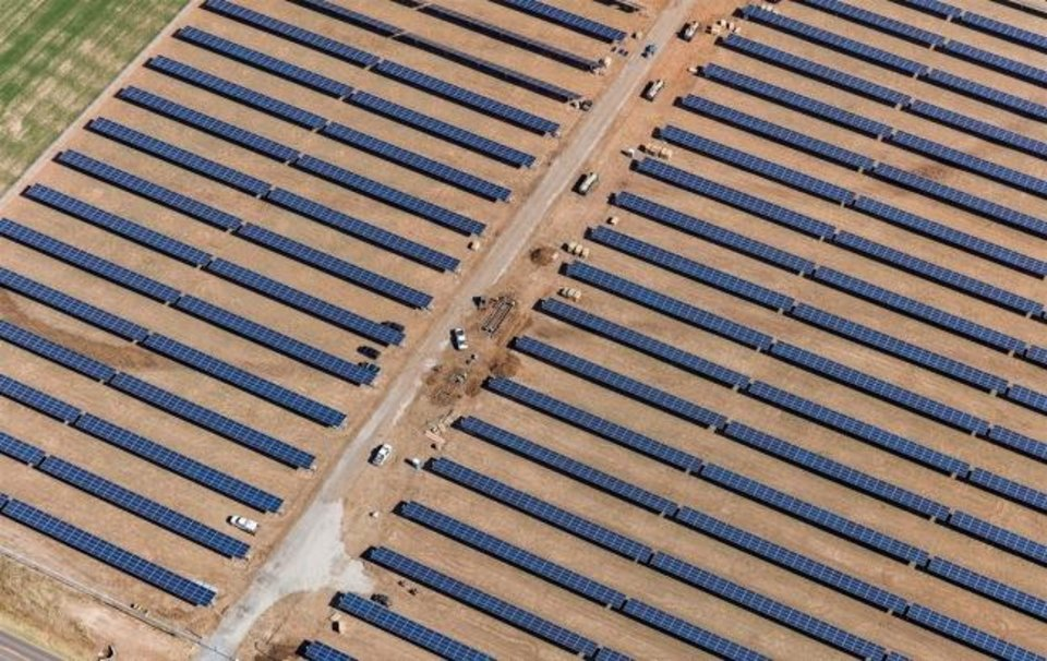 Photo -  This image shows an aerial view of a solar farm Oklahoma Gas and Electric Co. brought online near Covington in 2018. While the sun is a renewable energy source, Scott Tinker notes process and materials used to build the system impacted the global environment. [The Oklahoman Archives]