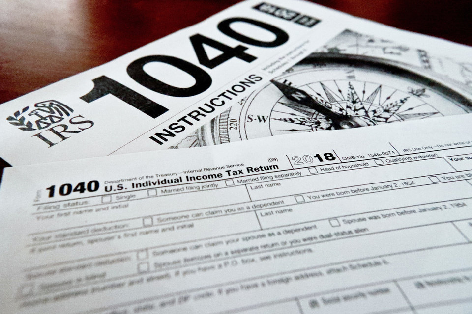 Photo -  This Feb. 13, 2019, file photo shows multiple forms printed from the Internal Revenue Service web page that are used for 2018 U.S. federal tax returns. [AP Photo/Keith Srakocic, File]