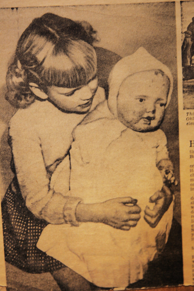 Photo - Copy of a 1949 newspaper clipping of Judy Braun with her mother Lillie's  doll that survived the Babbs Switch schoolhouse in 1924 on the 25th anniversary. Lillie take about the doll and other memories from the fire 85 years ago. Goes with Jim Etter story. Photo by David McDaniel, The Oklahoman