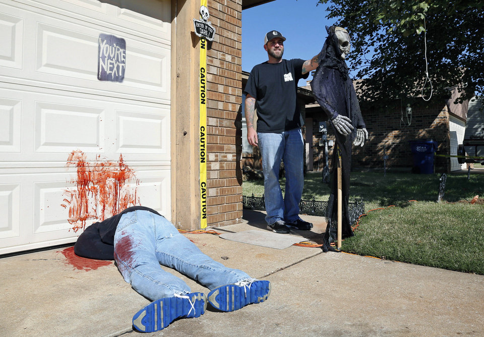 photo johnnie mullins poses with his halloween display featuring headless dummies dressed in his