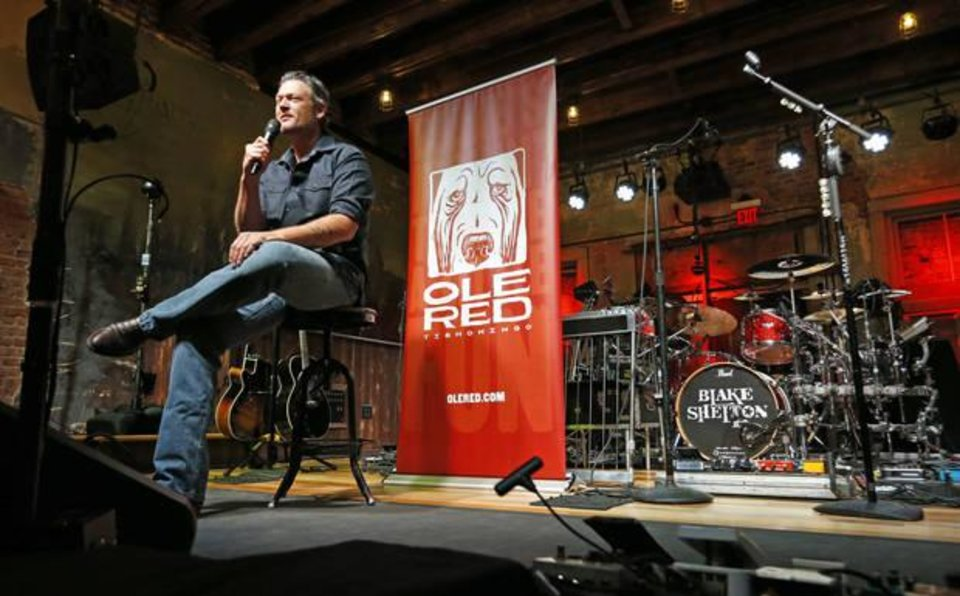 Photo - Entertainer Blake Shelton fields questions seated on the stage of his Ole Red restaurant/bar on Friday, Sept. 29, 2017 in Tishomingo, Okla. The Oklahoman Archives photo