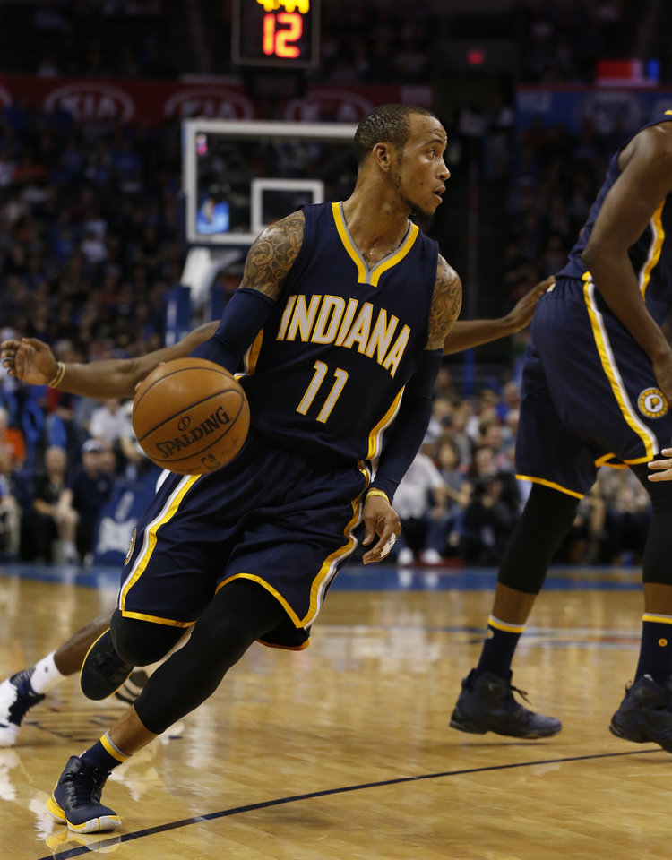 Photo - Indiana's Monta Ellis (11) dribbles in the first half of an NBA basketball game where the Oklahoma City Thunder play the Indiana Pacers at the Chesapeake Energy Arena in Oklahoma City, on Feb. 19, 2016.  Photo by Steve Sisney The Oklahoman