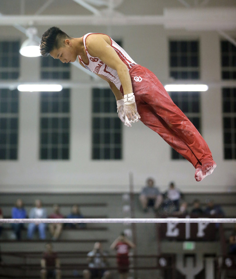 Photo - Oklahoma's Yul Moldauer competes on the high bar during the Mountain Pacific Sports Federation conference championship gymnastic meet inside McCasland Field House in Norman, Okla., Saturday, April 6, 2019. Photo by Bryan Terry, The Oklahoman