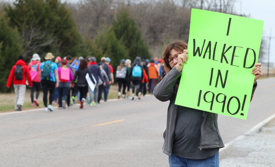 Photo - Joyce Lackey, a retired teacher who taught for 35 years in Putnam City, and now lives in Wellston, showed up in support during the March for Public Education by Tulsa teachers, students and supporters, who are walking to the Capitol from Tulsa along SH 66, Sunday, April 8, 2018. Photo by Doug Hoke, The Oklahoman