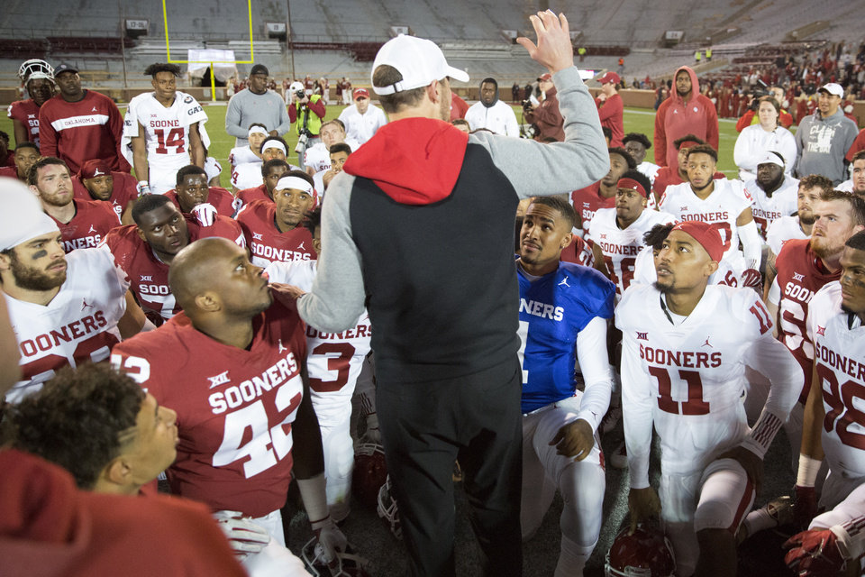 Photo - Oklahoma coach Lincoln Riley talks with his team, including Jalen Hurts (1), Parnell Motley (11), and Oklahoma's Mark Jackson (42) after the University of Oklahoma's (OU) spring football game at Gaylord Family-Oklahoma Memorial Stadium in Norman, Okla., Friday, April 12, 2019. Photo by Bryan Terry, The Oklahoman
