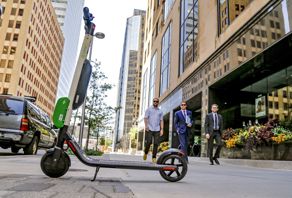 Photo - An electric scooter is pictured in downtown Oklahoma City. [The Oklahoman archives]