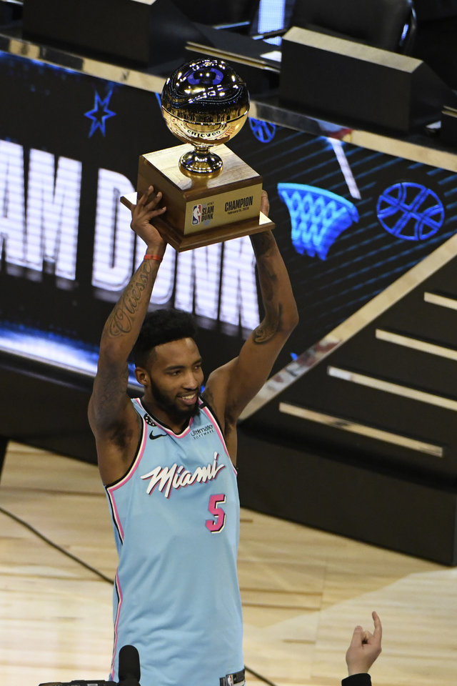 Photo - Miami Heat's Derrick Jones Jr. holds the trophy after winning the NBA All-Star slam dunk contest Saturday, Feb. 15, 2020, in Chicago. (AP Photo/David Banks)