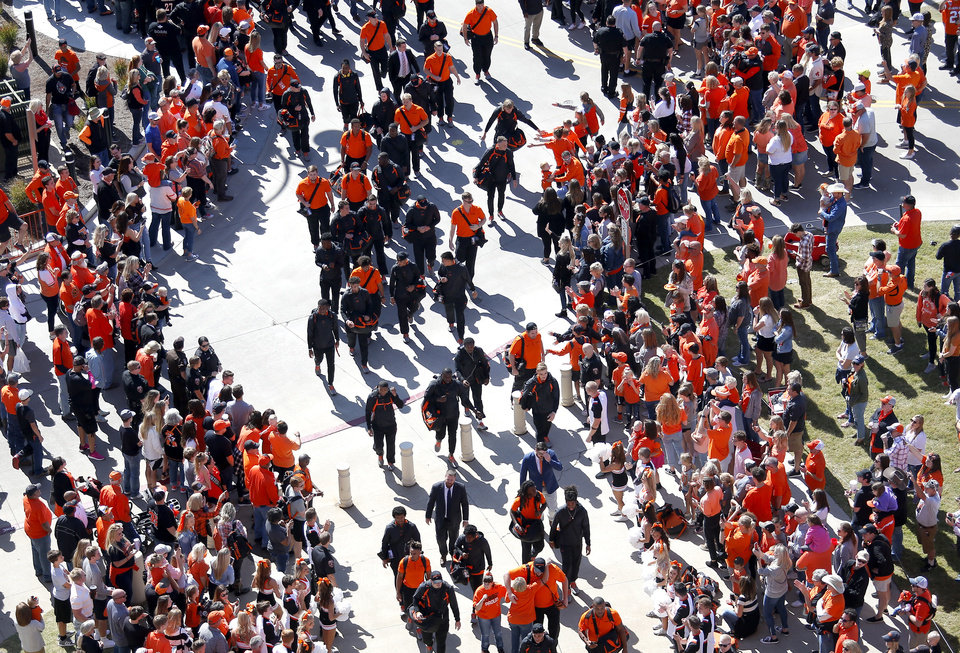 Photo - Fans cheer as OSU players walk in the stadium during the Spirit Walk before the college football game between Oklahoma State University and Baylor at Boone Pickens Stadium in Stillwater, Okla., Saturday, Oct. 19, 2019. [Sarah Phipps/The Oklahoman]