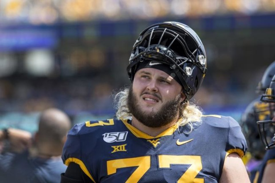 Photo -  Former West Virginia offensive lineman Josh Sills was a second-team All-Big 12 selection in 2018. [AP Photo/Raymond Thompson]