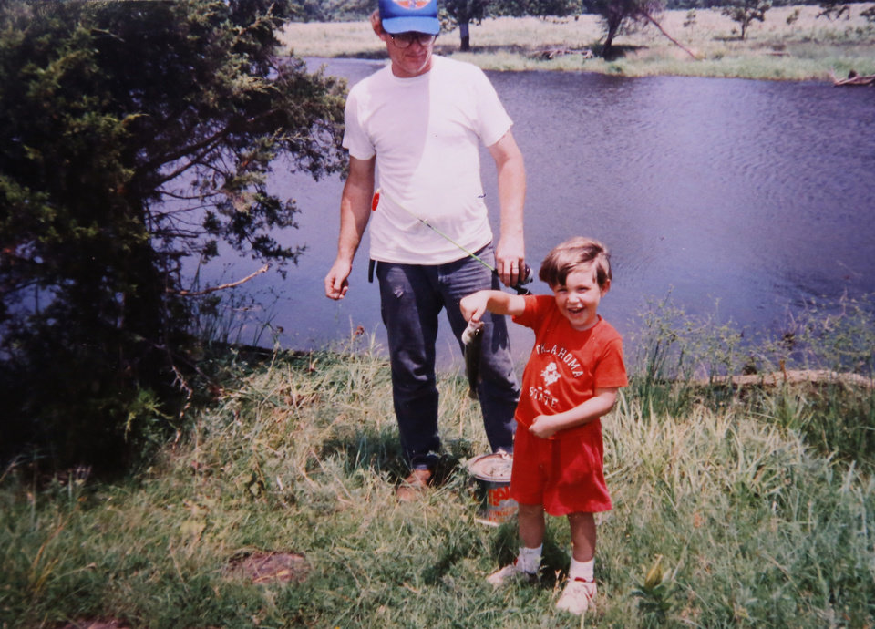 Photo -  A family photo depicts Michael Anthony Hughes fishing with his foster dad, Ernest Bean.