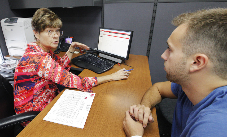 Photo - Debbie Quiery, vice president of the Northern Oklahoma College Stillwater campus, advises Max Murphree on Aug. 18 about courses at the school.  PAUL B. SOUTHERLAND