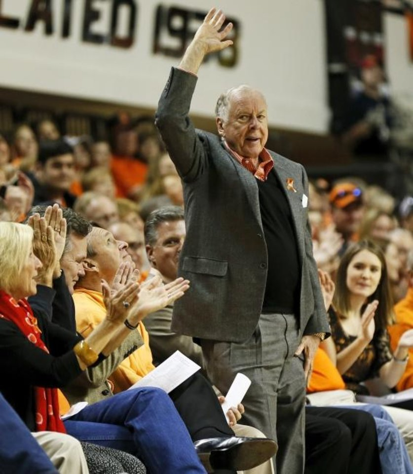 Photo -  Boone Pickens waves to fans during an OSU game against West Virginia at Gallagher-Iba Arena on Jan. 26, 2013. [Nate Billings/Oklahoman]