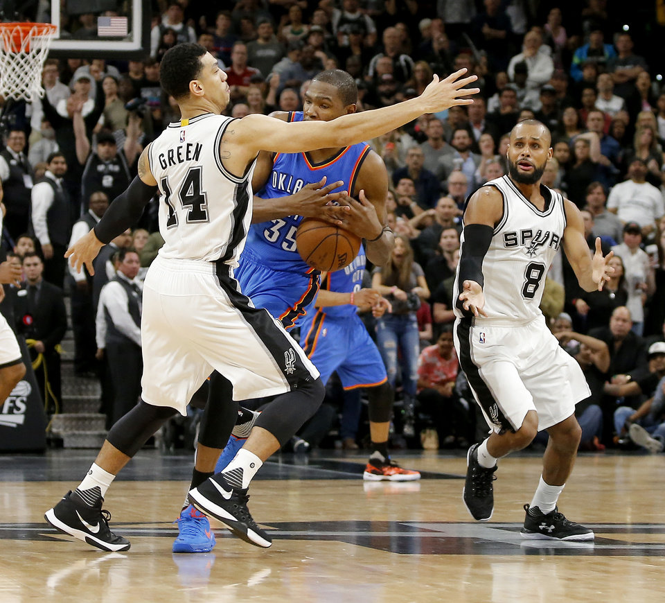 Photo - Oklahoma City's Kevin Durant (35) loses the ball between San Antonio's Danny Green (14) and Patty Mills (8) in the final seconds of Game 2 in the second-round series between the Oklahoma City Thunder and the San Antonio Spurs in the NBA playoffs at the AT&T Center in San Antonio, Monday, May 2, 2016. Oklahoma City won 98-97. Photo by Bryan Terry, The Oklahoman