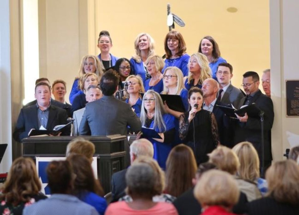 Photo -  The Voices of Crossings perform on Thursday at the 2019 National Day of Prayer service at the state Capitol. [Doug Hoke/The Oklahoman]