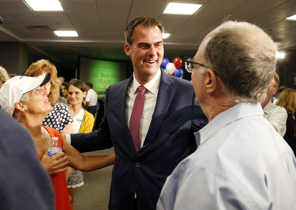 Photo - Kevin Stitt comes out to talk to people at his watch party for Oklahoma Governor candidate Kevin Stitt at Gateway Mortgage in Jenks, OK, June 26, 2018. STEPHEN PINGRY/Tulsa World