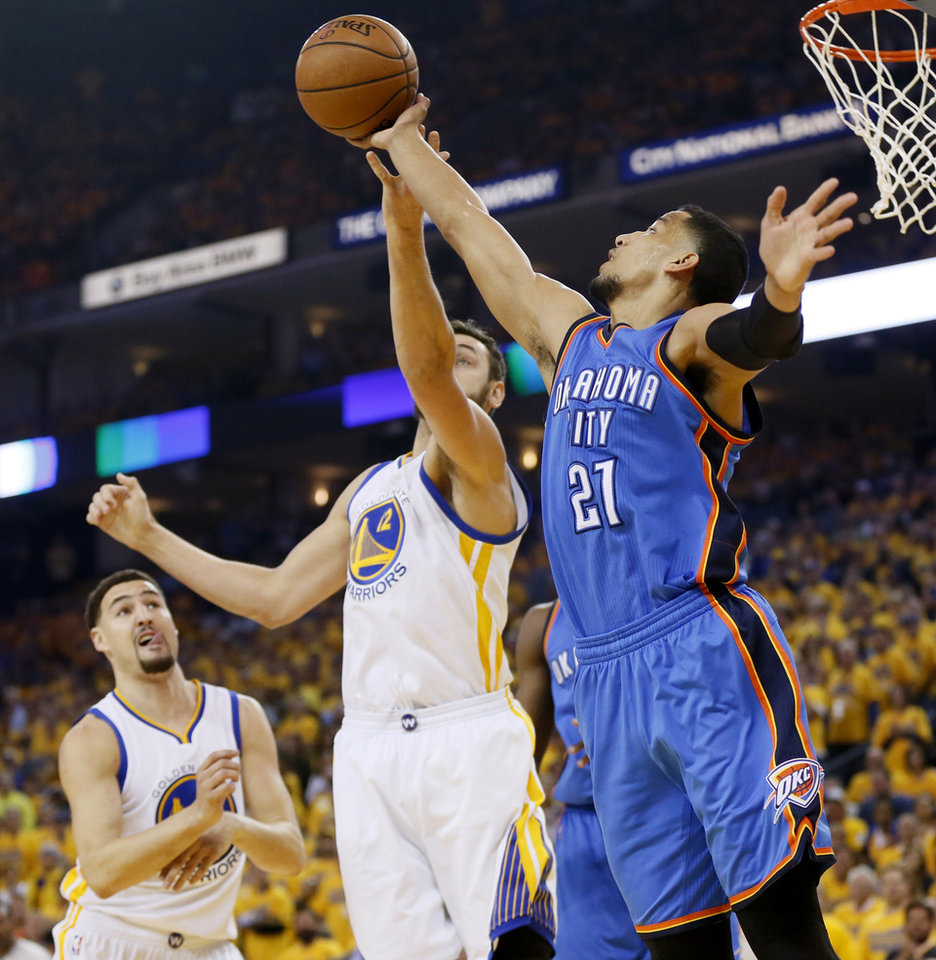 Photo - Oklahoma City's Andre Roberson (21) goes for a rebound beside Golden State's Andrew Bogut (12) and Klay Thompson (11) during Game 5 of the Western Conference finals in the NBA playoffs between the Oklahoma City Thunder and the Golden State Warriors at Oracle Arena in Oakland, Calif., Thursday, May 26, 2016. Photo by Nate Billings, The Oklahoman
