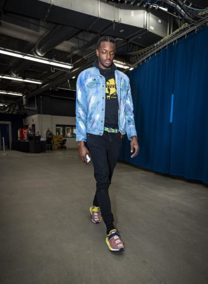 Photo -  Oklahoma City forward Jerami Grant, wearing a jacket he painted himself, enters Chesapeake Energy Arena ahead of a game between the Thunder and Warriors on March 16. [ZACH BEEKER/OKC THUNDER]