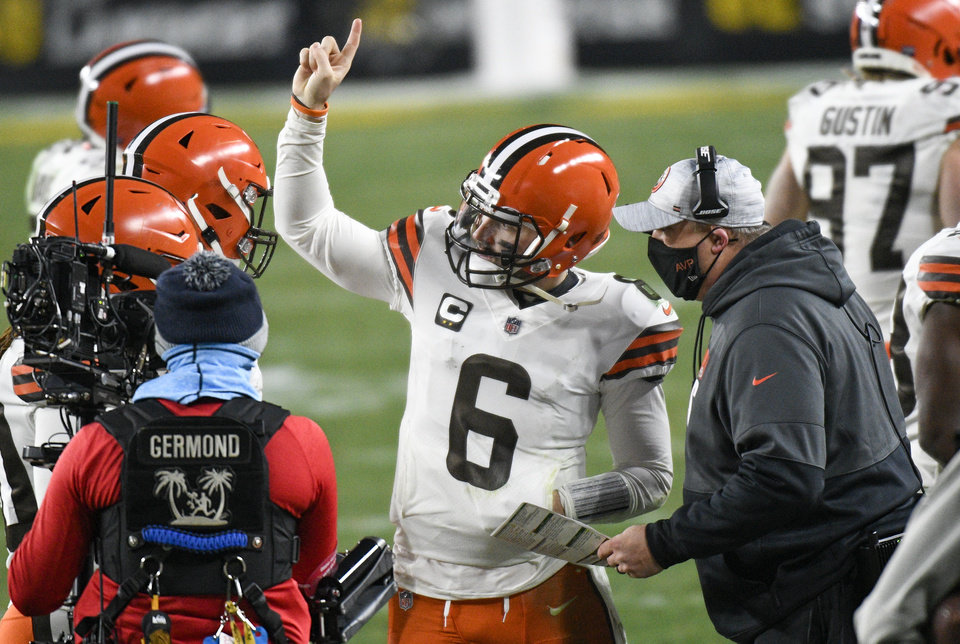 Photo -  Browns offensive coordinator Alex Van Pelt, right, talks with quarterback Baker Mayfield (6) on the sideline during the second half against the Steelers on Sunday in Pittsburgh. [Don Wright/The Associated Press]