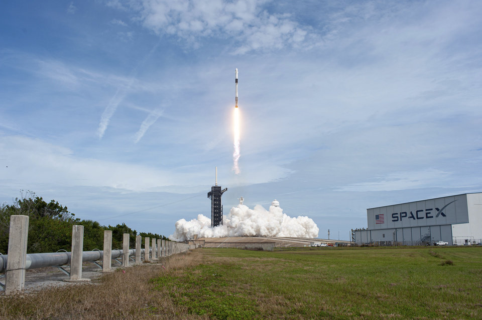 Photo -  FILE - In this Jan. 19, 2020 file photok a SpaceX Falcon 9 rocket lifts off from Launch Complex 39A at NASA's Kennedy Space Center in Cape Canaveral, Fla., carrying the unmanned Crew Dragon spacecraft on the company's In-Flight Abort Test. The flight test demonstrated the spacecraft's escape capabilities in preparation for crewed flights to the International Space Station as part of the agency's Commercial Crew Program. (Tony Gray/NASA via AP)