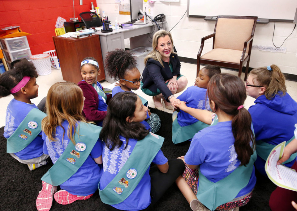 Photo -  U. S. Rep. Kendra Horn greets members of a Girl Scout troop on Monday afternoon, at Positive Tomorrows. [Jim Beckel/The Oklahoman]