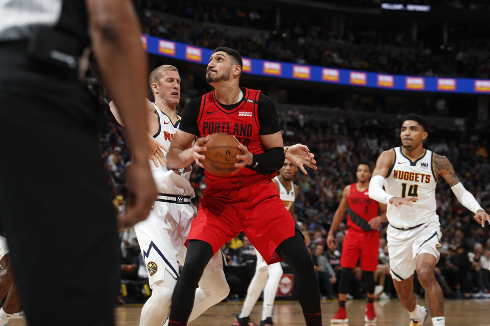 Photo - Portland Trail Blazers center Enes Kanter (00) in the second half of Game 2 of an NBA basketball second-round playoff series Wednesday, May 1, 2019, in Denver. Portland won 97-90. (AP Photo/David Zalubowski)