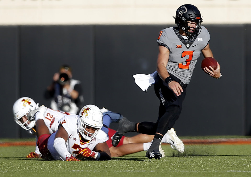 Photo - Oklahoma State's Spencer Sanders (3) gets by the Iowa State defense in the third quarter during the college football game between the Oklahoma State University Cowboys and Iowa State Cyclones at Boone Pickens Stadium in Stillwater, Okla., Saturday, Oct. 24, 2020. Photo by Sarah Phipps, The Oklahoman