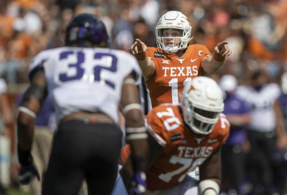 Photo -  Texas quarterback Sam Ehlinger (11) calls out his protection against TCU in a 33-31 loss last Saturday in Austin. [Ricardo B. Brazziell/USA TODAY Sports]