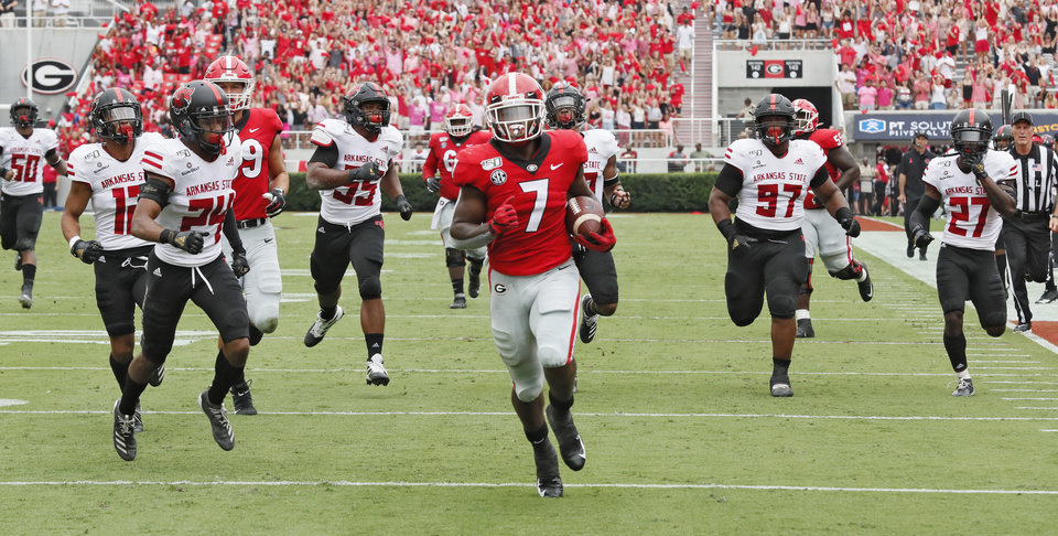 Photo - Georgia Bulldogs running back D'Andre Swift (7) scores on a pass play which he broke for a touchdown during the first half of todays Georgia vs Arkansas State NCAA football game at Sanford Stadium in Athens. (Bob Andres/Atlanta Journal-Constitution via AP)