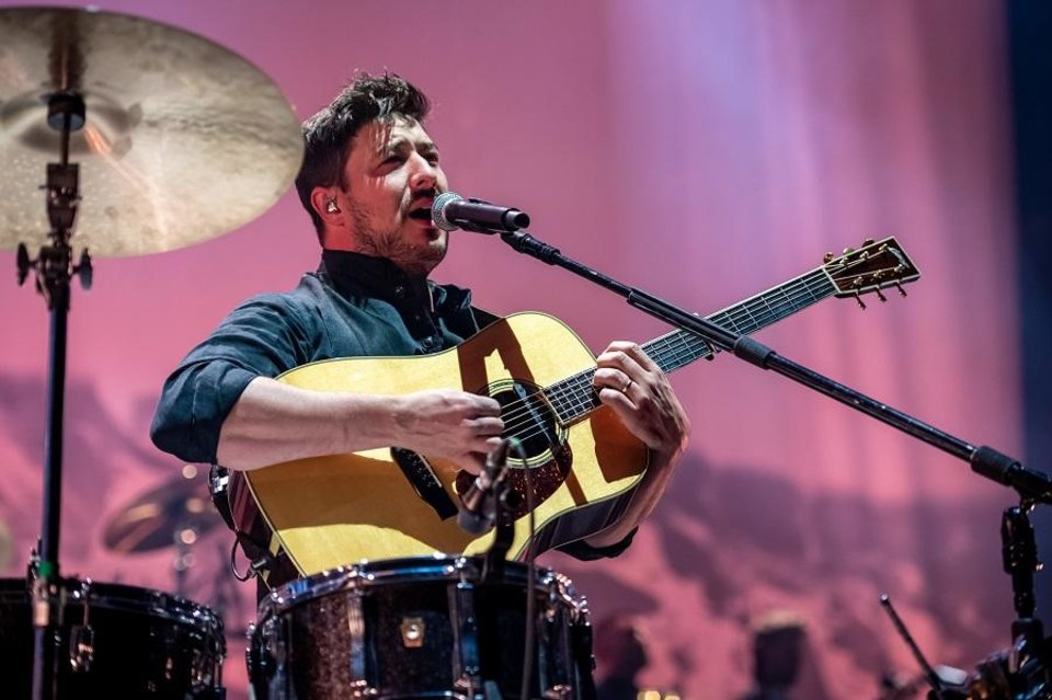 Photo - Marcus Mumford, frontman of Mumford & Sons, performs Friday night at Chesapeake Energy Arena. [Photo provided by Rob Ferguson]
