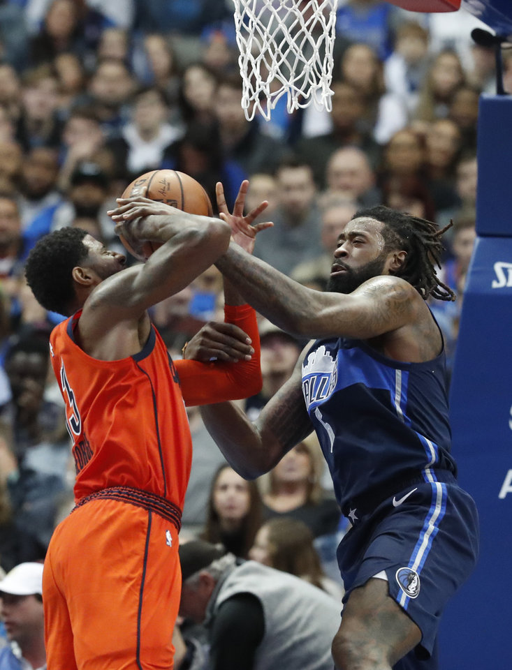 Photo - Oklahoma City Thunder forward Paul George (13) is stoped at the basket by Dallas Mavericks center DeAndre Jordan (6) during the second half of an NBA basketball game in Dallas, Sunday, Dec. 30, 2018. The Mavericks won 105-103. (AP Photo/LM Otero)