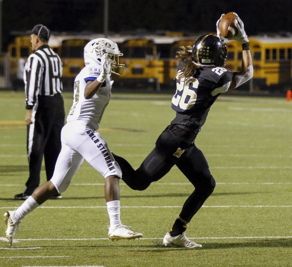 Photo - Midwest City's Dylan Sebock (26) makes a catch during a high school football game between Midwest City and Choctaw at Rose Field in Midwest City, Okla., Friday, Nov. 1, 2019. [Nate Billings/The Oklahoman]
