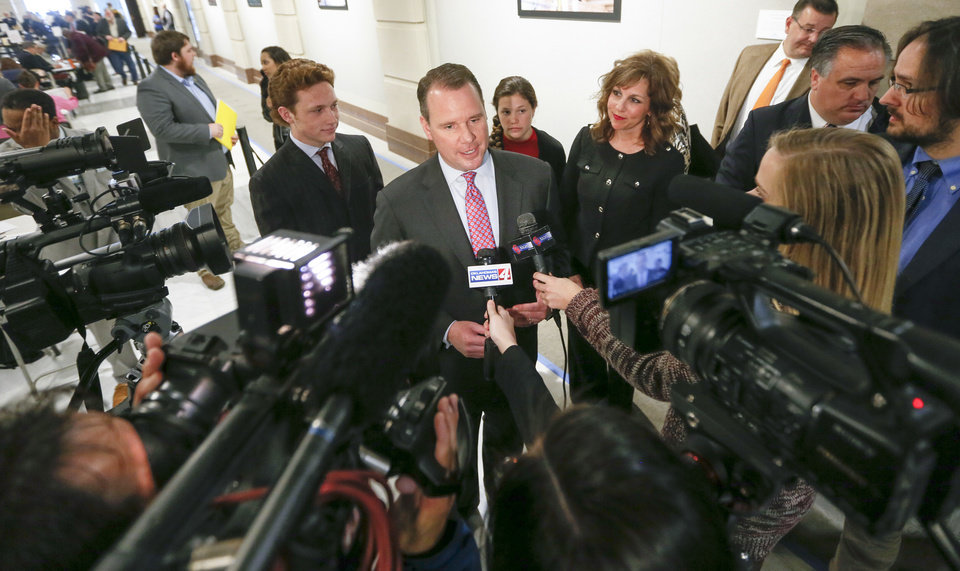 Photo - CORRECTS DATE - Oklahoma Lt. Gov. Todd Lamb speaks to the media after filing to run for governor as a Republican during candidate filing at the Oklahoma state Capitol in Oklahoma City, Wednesday, April 11, 2018. (Nate Billings/The Oklahoman via AP)