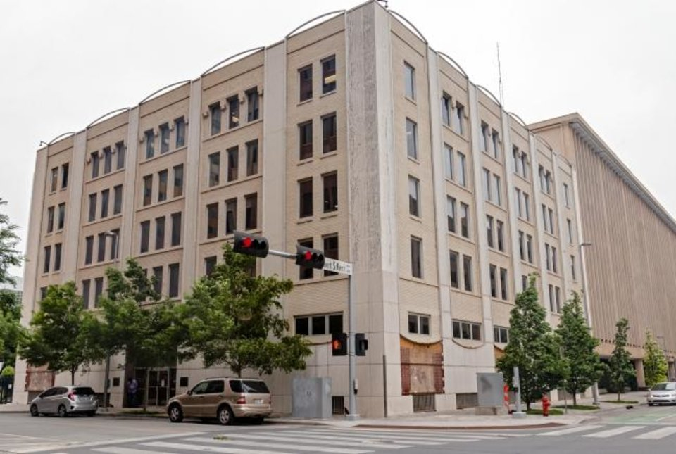 Photo -  Panels and remants of screening added to the facade of the Investors Capital Building, 217 N Harvey Ave., will be removed and the original brick facade from when it was built will be restored.  [CHRIS LANDSBERGER/THE OKLAHOMAN]